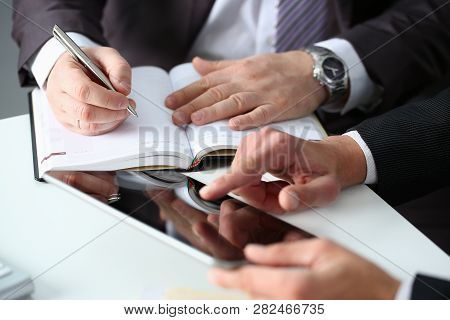 Hand Of Businessman In Suit Filling And Signing With Silver Pen Partnership Agreement Form Clipped T