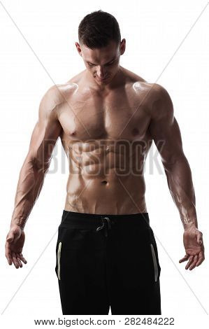 Handsome Shirtless Athletic Man Posing On White