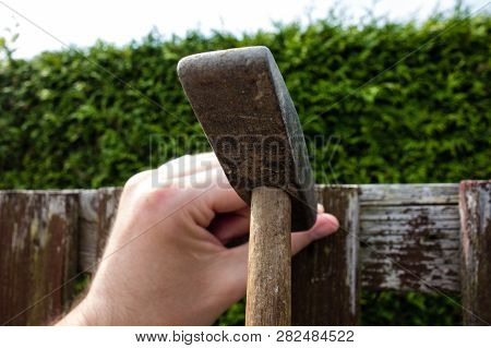 Hammer The Nail Into The Wood With A Hammer