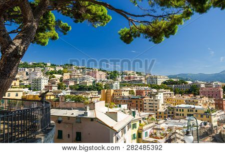 Colorful Buildings On Hill In City District Of Genoa Genova And Ligurian Appennines Mountain Range W