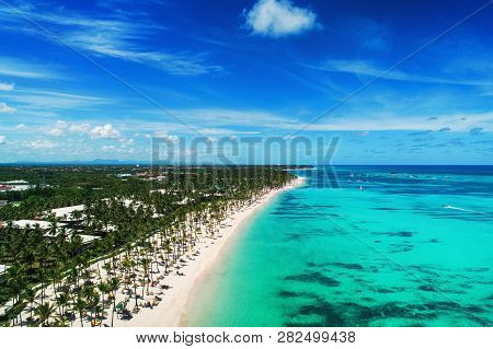 Aerial View Of Punta Cana Beach Resort, Dominican Republic. Summer Holiday With Parasailing, Diving,