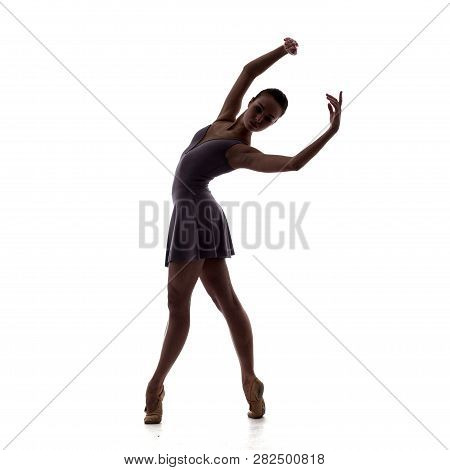 Silhouette Of Young Beautiful Ballet Dancer In Lilac Dress Isolated On White Studio Background
