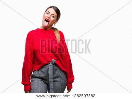 Young beautiful business woman wearing winter sweater over isolated background sticking tongue out happy with funny expression. Emotion concept.