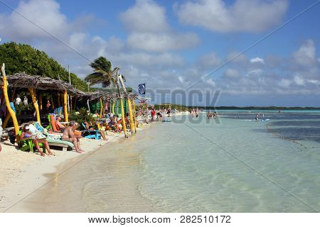 Bonaire Island, January, 2009, Tourist Enjoying The  Public Beach On The Island Of Bonaire