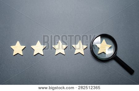 Five Stars And A Magnifying Glass On The Last Star. Check The Credibility Of The Rating Or Status Of