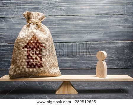 Money Bag With Up Arrow And Man Figurine On Scales. Criteria And Requirements For Increasing The Wor