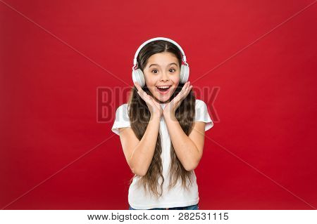 Girl Listen Music Headphones On Red Background. Play List Concept. Music Taste. Music Plays An Impor