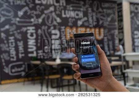 Chiang Mai, Thailand - Jan. 06,2019: Man Holding Huawei With Vimeo On Screen.  Vimeo Is A Video-shar