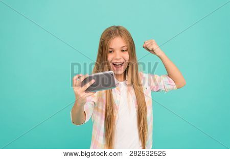 Exciting Video Message. Cute Mobile Phone Technology User. Little Girl Using Mobile Phone. Small Gir