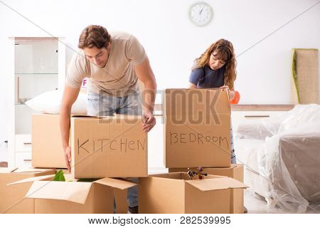 Young pair moving to new appartment
