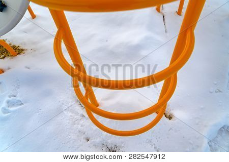 Bright Orange Ladder Against Powdery Shite Snow