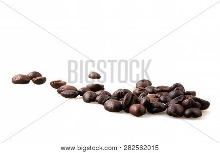 Roasted Coffee Beans Over White Background Stock Photos