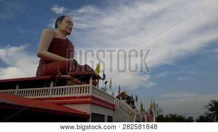 Big Budha Statue With Cloud Sky In Thailand