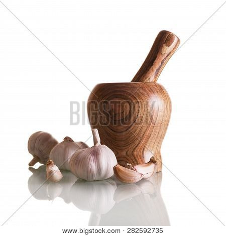 Fresh Head Of Garlic And Cloves. Mortar For Cooking Sauce Isolated On White Background