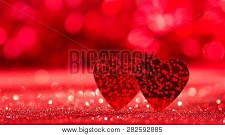Valentine's Day Concept. Two Red Hearts On Bright Sparkling Background.