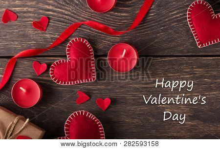 Happy Valentines Day Concept. Composition Of Red Hearts, Gifts And Candles On A Wooden Background