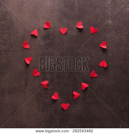 Happy Valentines Day Concept. Bright Beautiful Heart Of Small Red Hearts On A Dark Background
