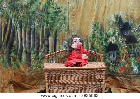 Red Puppet Sitting