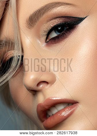 Portrait Of Young Beautiful Woman With Evening Make Up. Modern Fashion Eyeliner Wing. Studio Shot. E