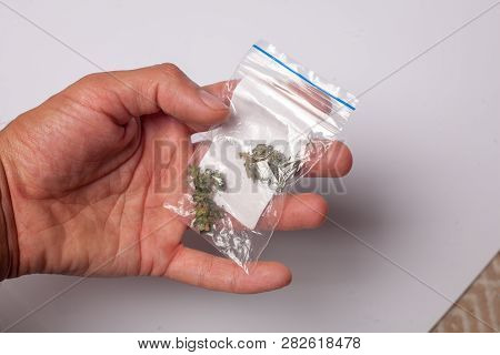 A Package Of Illicit Cannabis In Hand. Medical Marijuana For Treatment By Prescription. Drug Dealer