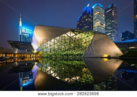 GUANGZHOU, CHINA - APRIL 27, 2018: Guangzhou Opera House designed by famous Iraqi architect architect Zaha Hadid illluminated at night