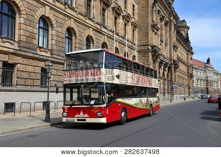Dresden, Germany - May 10, 2018: Tourists Ride A Double Decker Bus City Tour In Altstadt (old Town)