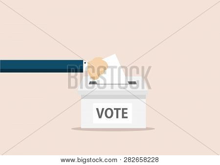 Hand Puts Voting Ballot In Ballot Box. Voting And Election Concept