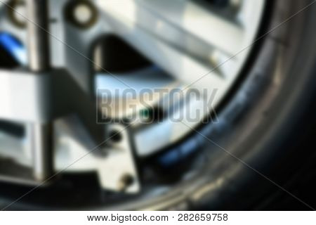 The Blurred Of Metal Wheel While Waiting On The Stop Position During Wheel Alignment At The Car Repa