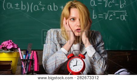 Time Management. Teacher With Alarm Clock At Blackboard. Time. Study And Education. Modern School. K