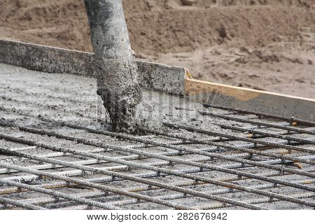 The Organization Of Concrete Work. Pouring Concrete At A Construction Site. Construction Of A New Bu
