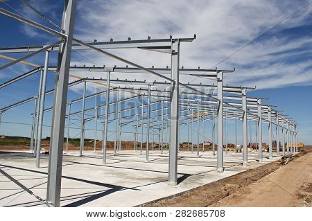 Part Of The Building Structure Of Galvanized Parts. Galvanized Parts On A Construction Site In Sunny