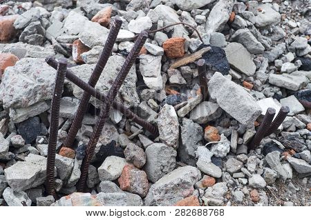 The Rebar Sticking Up From Piles Of Brick Rubble, Stone And Concrete Rubble. Remains Of The Destroye