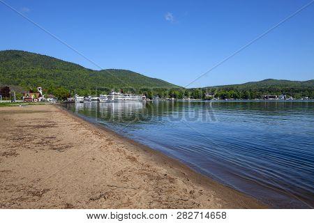 The Beautiful Sandy Shoreline Of Lake George In New York
