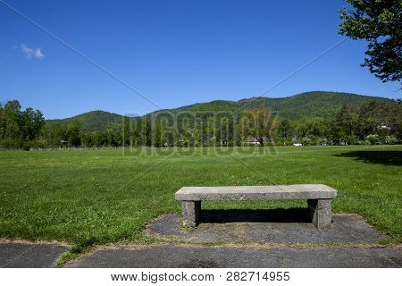 A Stone Bench In Battlefield State Park In Lake George New York