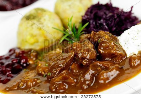 Gourmet Venison goulash with potato dumplings and garnish