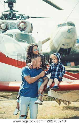 Going High. Air Travel. Family Vacation. Family Couple With Boy Kid On Vacation Trip. Mother And Fat