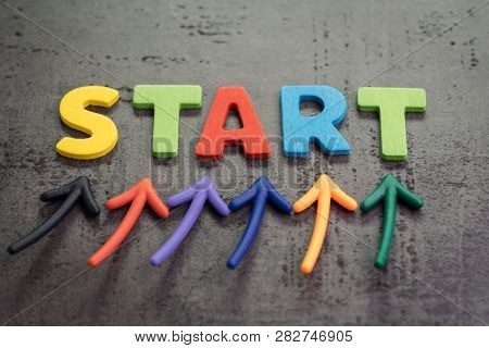 Business Start Or Begin New Life Journey Concept, Colorful Arrows Point Up To Word Start On Blackboa