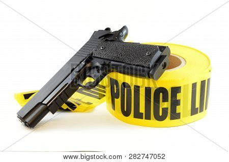 An Isolated On White Image Of Some Police Tape And A Handgun For Law Enforcement Concepts.