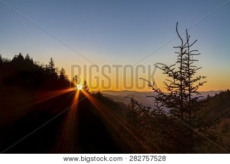The Morning Sun Rises Over The Appalachian Ridges Of The Great Smoky Mountains National Park Near Th