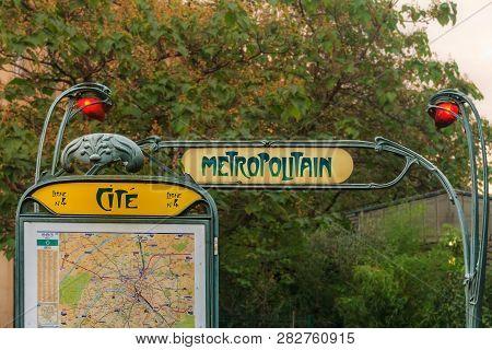 Ornate Art Deco Or Art Nouveau Parisian Metro Sign With A Map Fragment At The Ile De La Cite Stop Ne