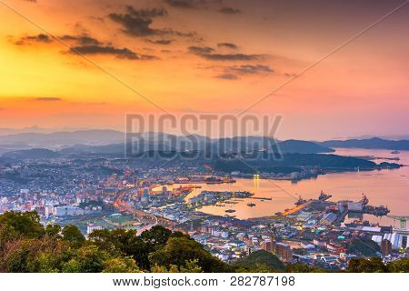 Sasebo, Nagasaki, Japan downtown city skyline on the bay at dawn.