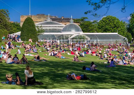 Glasgow, Scotland - May 28:  Overcrowded Park Full Of Relaxing People. Glasgow Botanic Gardens On Ma