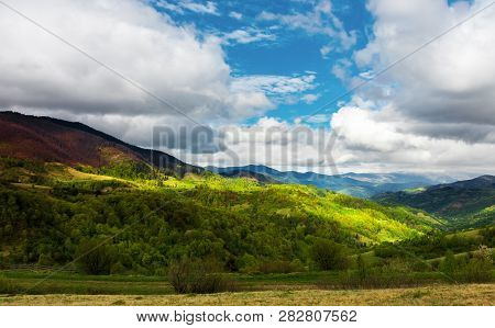 Beautiful Sunny Morning In Mountains. Carpathian Countryside In Spring. Village In The Distant Valle