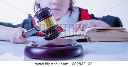 One Law For All Concept. Serious Child Girl Judge (lawyer). Humorous Photo.