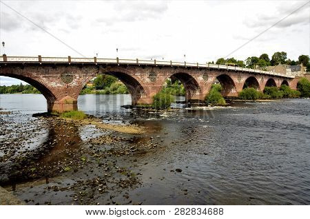 A View Of The River Tay As It Flows Through The City Of Perth In Scotland