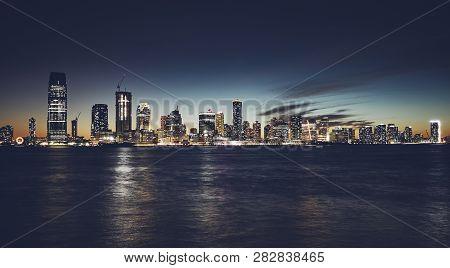 Jersey City Skyline At Night, Usa.