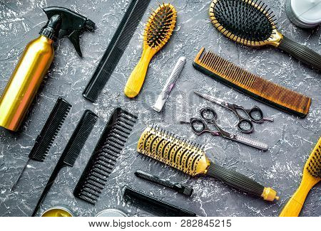 Hairdressing Concept With Barber Tools On Gray Background Top View