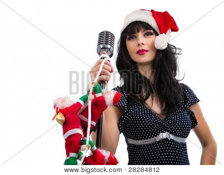 Christmas Singer standing in front of a microphone. Isolated on a white background