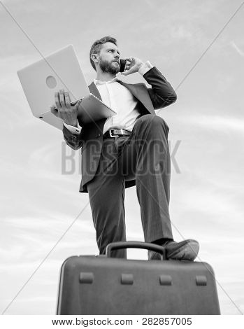 Man Well Groomed Businessman Holds Laptop Blue Sky Background. Guy Formal Suit Modern Technology Man