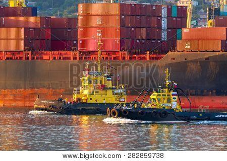 Novorossiysk, RUSSIA - JULY 24, 2018: two tugboats in the port of Novorossiysk